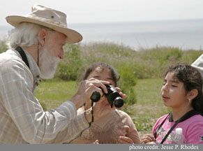 Bob Hansen Coaches Two Students On How To Properly Adjust Their Binoculars.